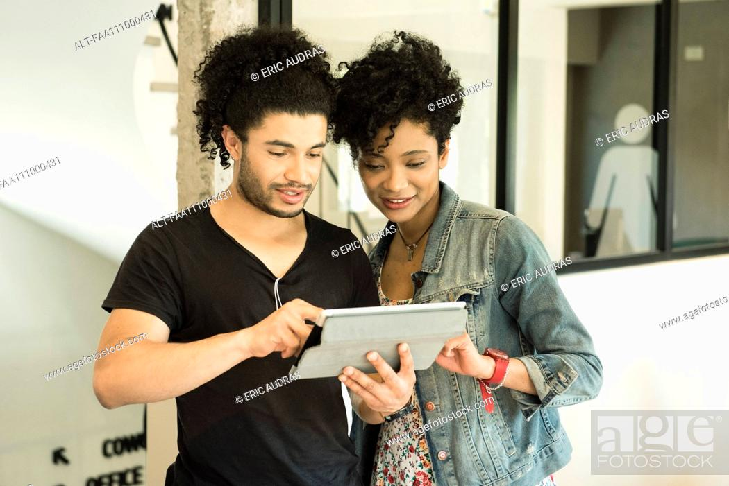 Stock Photo: Couple using digital tablet together.