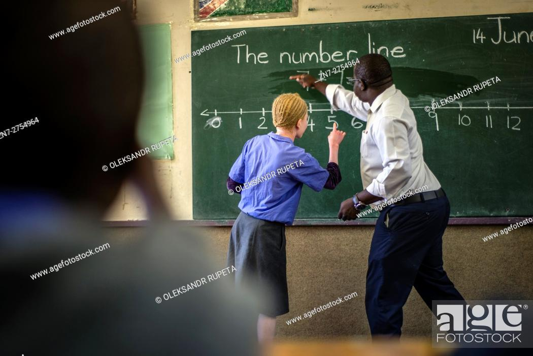 Stock Photo: The teacher Richard Tjaronda shows easy way of counting with the number line for his learners during Mathematic lesson at Eluwa Special School in Ongwediva.