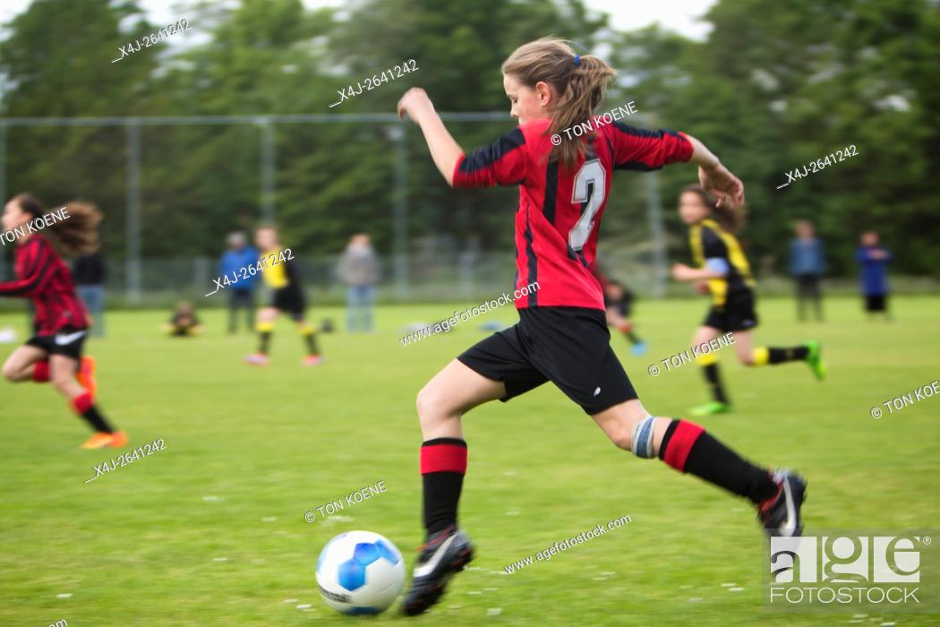Photo de stock: Girls playing football in Holland.