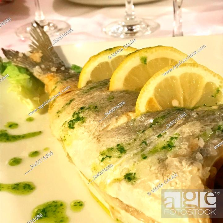 Stock Photo: Grilled sea bass with lemon, olive oil and parsley. Spain.