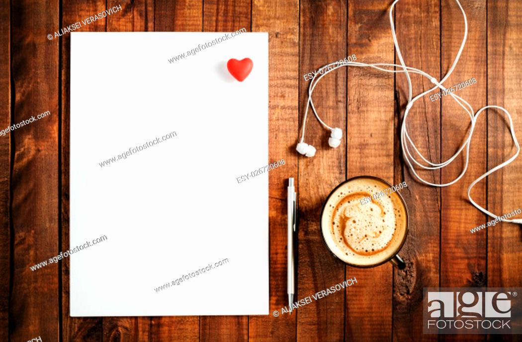 Stock Photo: Blank branding template on vintage wooden table background. Blank white paper, letterhead, pen, headphones and red heart.