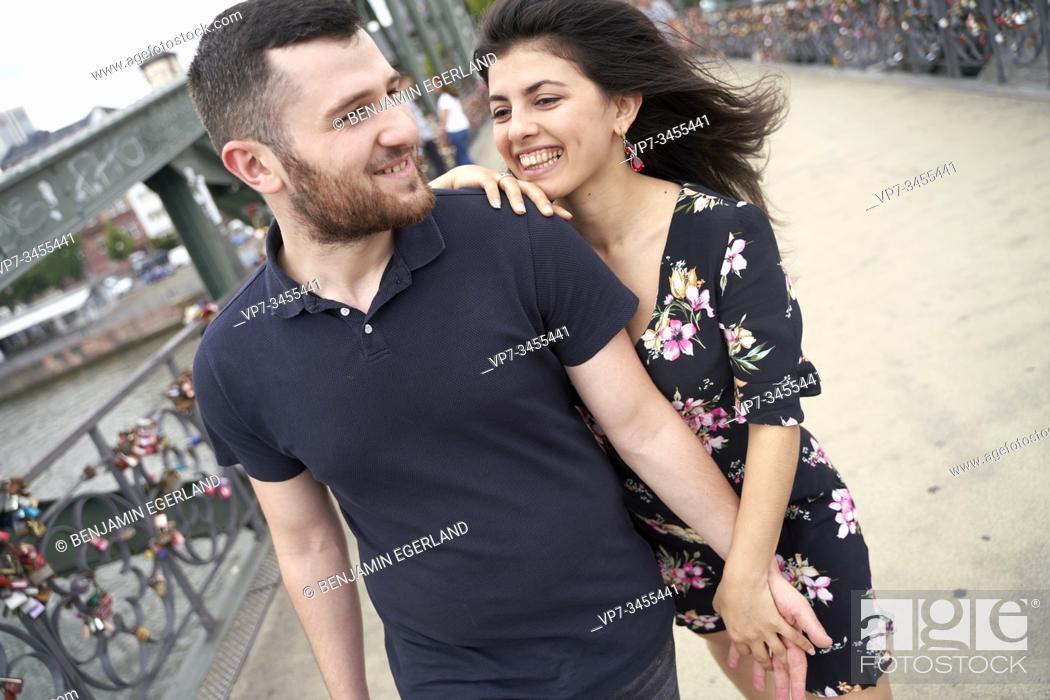 Photo de stock: Young couple walking on bridge. Frankfurt am Main, Germany.