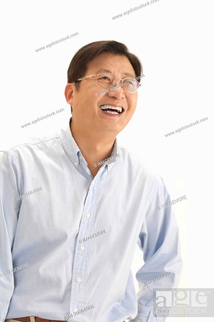 Stock Photo: Husband, Man looking away and laughing.