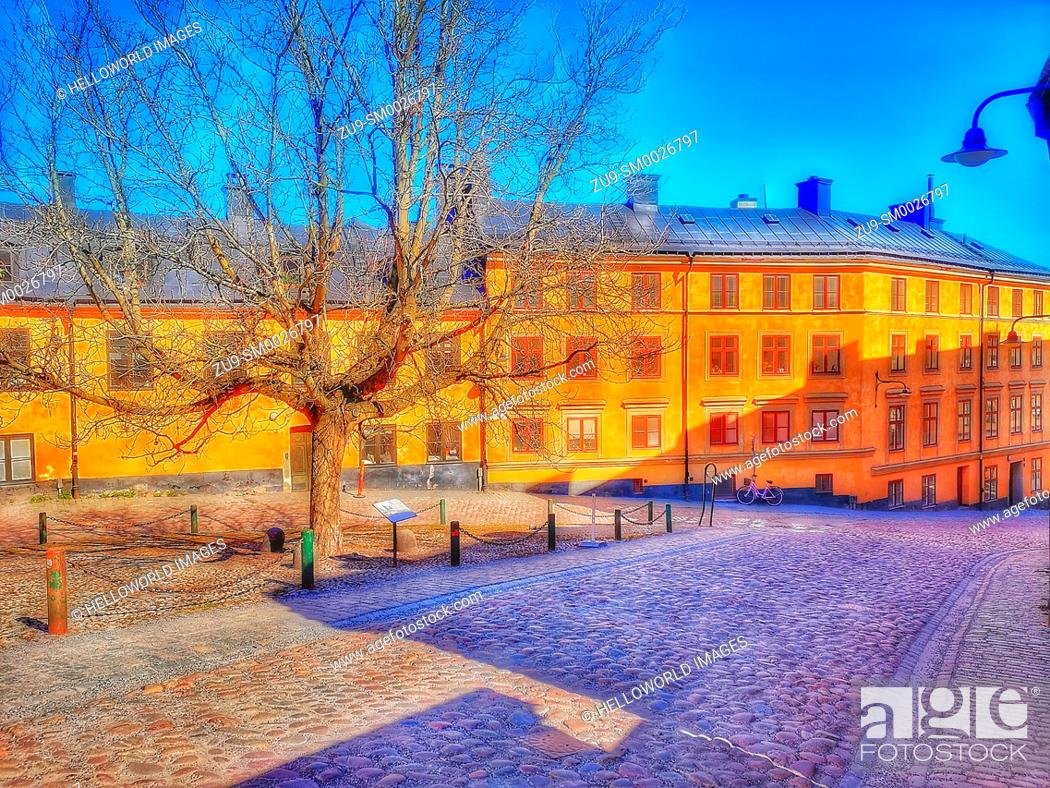 Stock Photo: Small triangular cobbled square where Bastugatan meets Pryssgrand, Sodermalm, Stockholm, Sweden, Scandinavia. Well preserved 18th century houses.