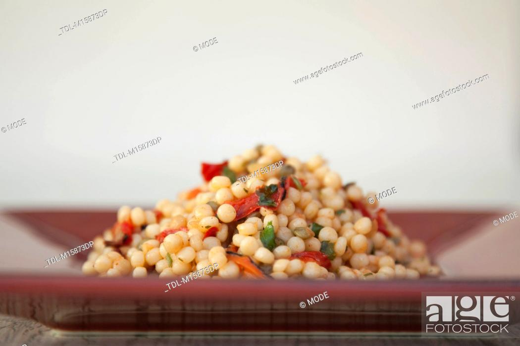 Stock Photo: Giant Couscous on a plate.