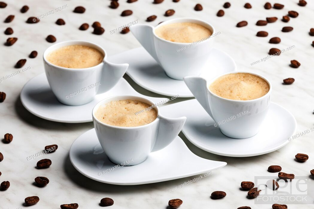 Stock Photo: four cups of coffee with milk.