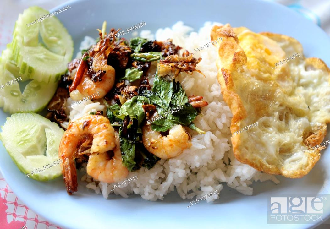 Stock Photo: stir fried prawn with basil and fried egg top on rice, typical lunch time food in bangkok, thailand.