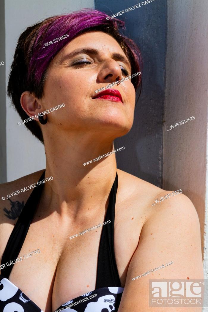 Stock Photo: Pretty woman portrait enjoy sunbath.