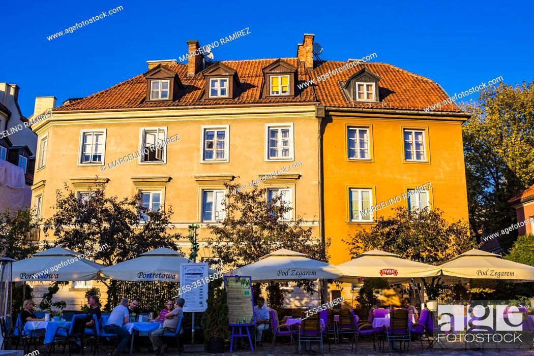 Stock Photo: Portretowa restaurant terrace on Rycerska street, near old medieval defensive walls. Warsaw, Poland, Europe.