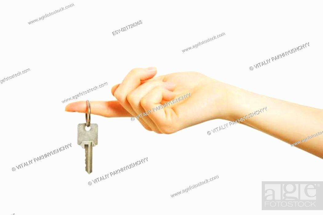 Photo de stock: hand holds a key.