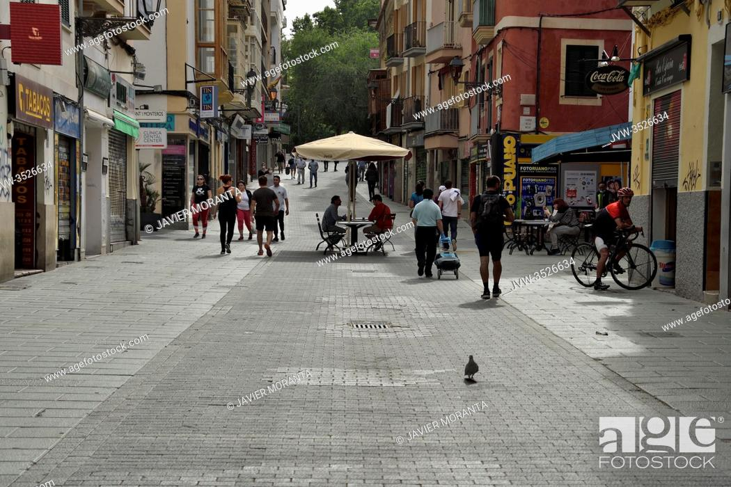 Stock Photo: People strolling, shopping and bar terraces during phase 1 of the unconfinement in Palma de Mallorca, Spain.