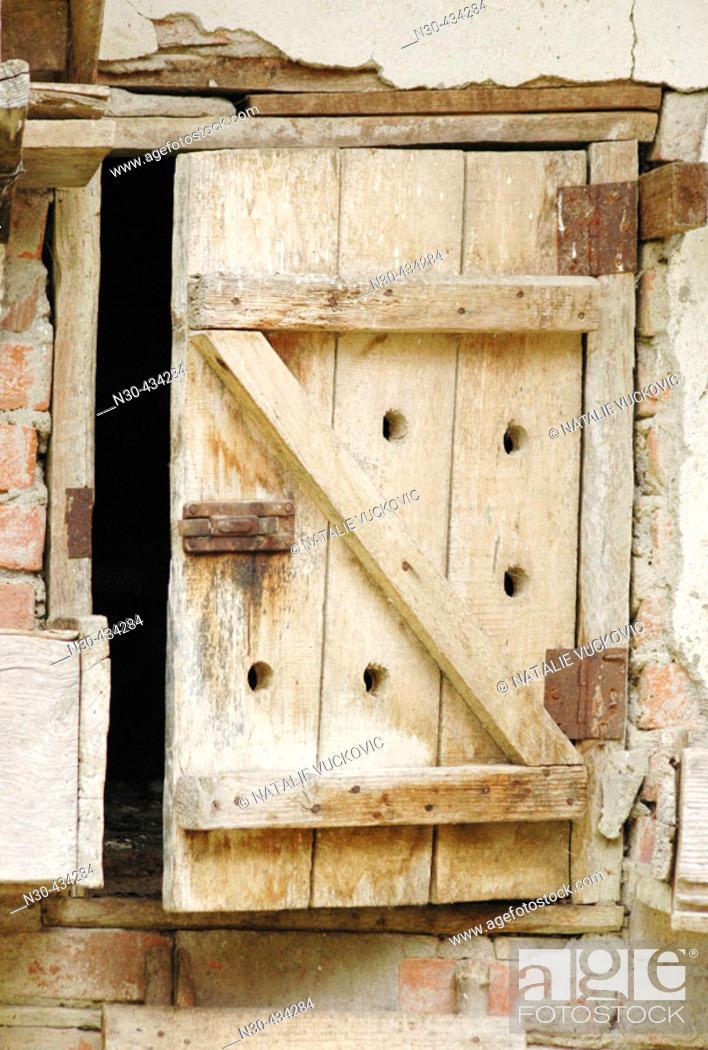 Stock Photo: Chicken Coop Door on Rural European Farm.