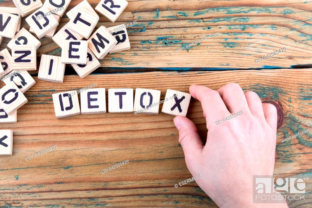 Stock Photo: detox. Wooden letters on the office desk, informative and communication background.