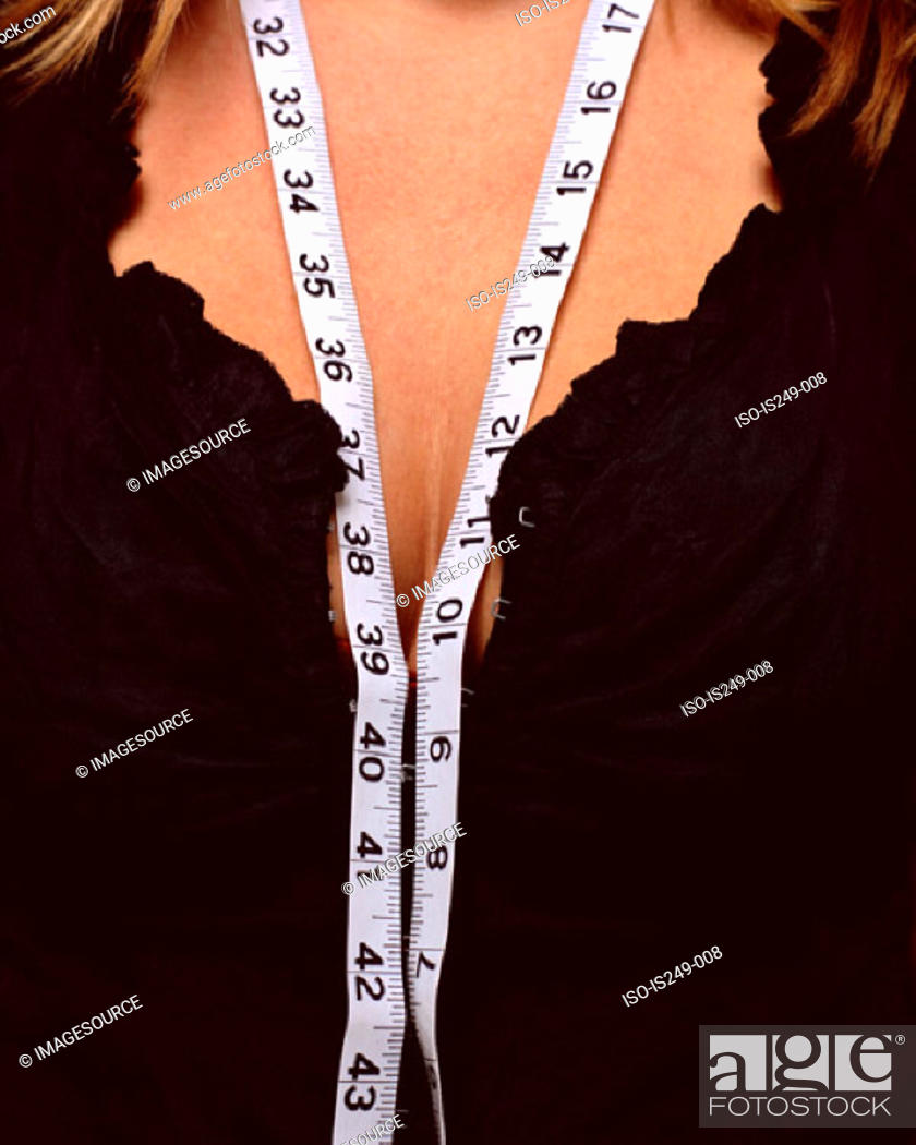 Stock Photo: Tape measure on cleavage.