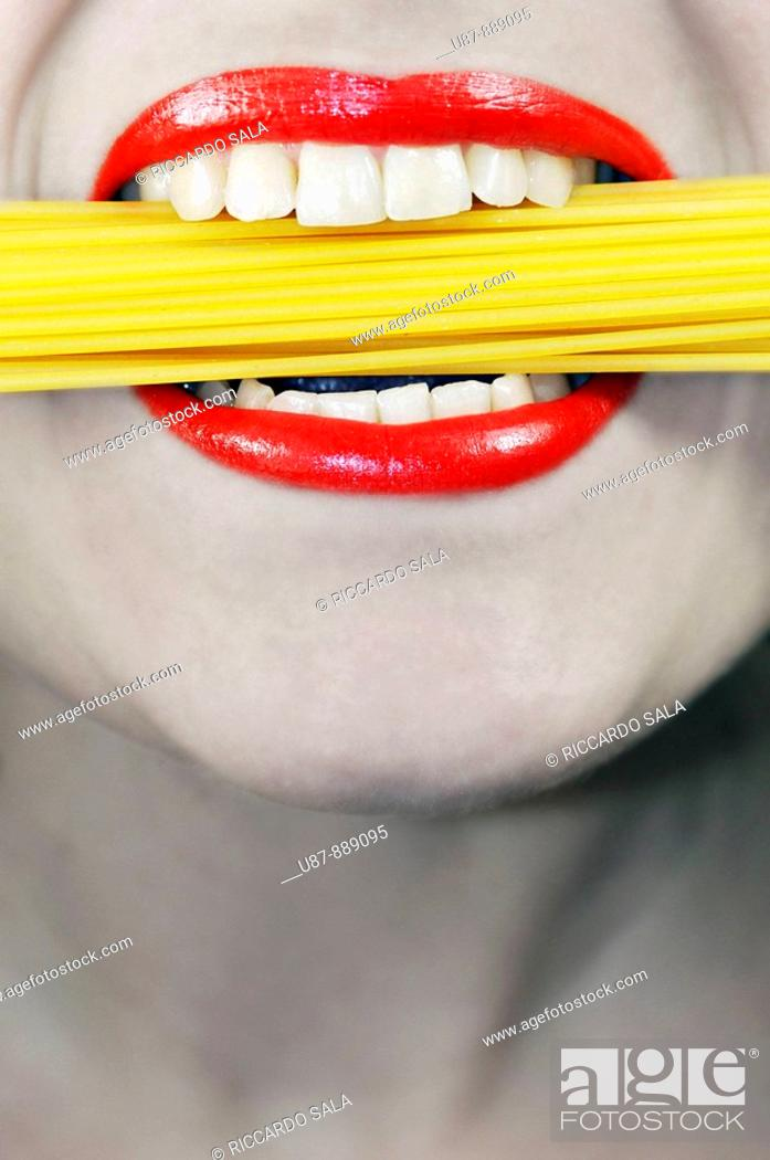 Stock Photo: Woman Eating Pasta Spaghetti.