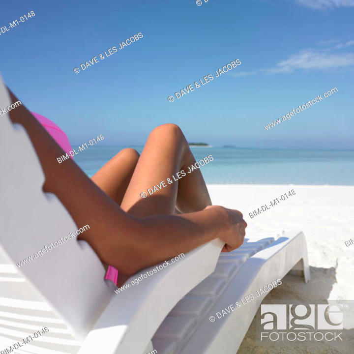 Stock Photo: Young woman sunbathing on the beach.