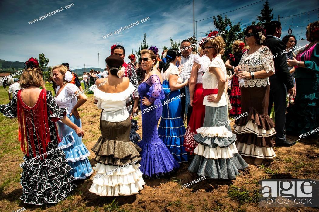 Stock Photo: Women dressed in traditional costume ruffled, Andalusian pilgrimage in Villaviciosa, Asturias, Spain.