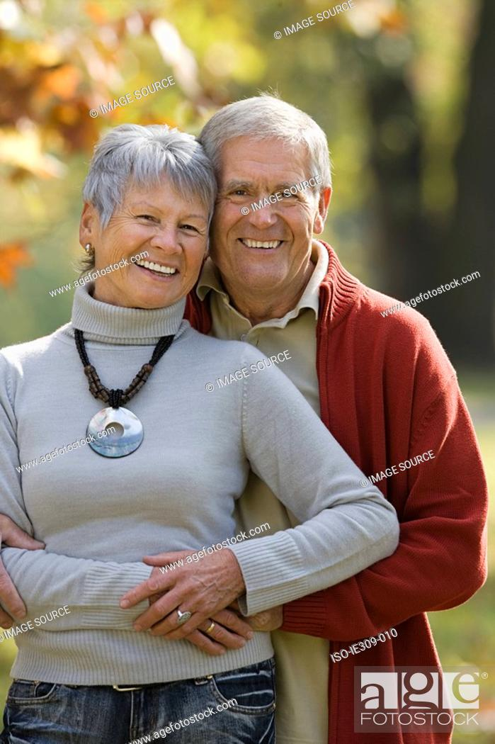 Stock Photo: Senior couple hugging.