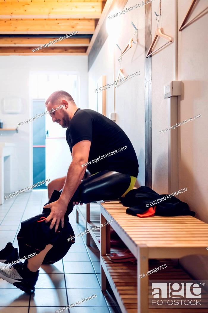 Stock Photo: Man with prosthetic leg in gym changing room.