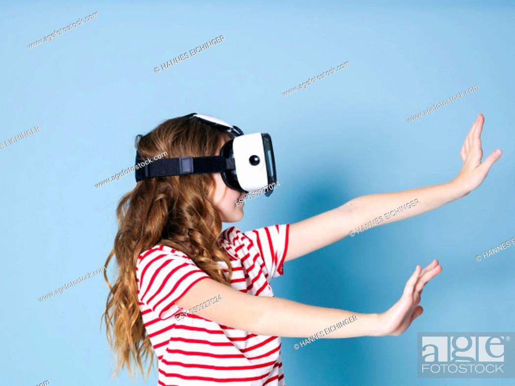Stock Photo: smiling positive girl wearing virtual reality glasses goggles headset, vr box. connection, modern, new generation, concept.