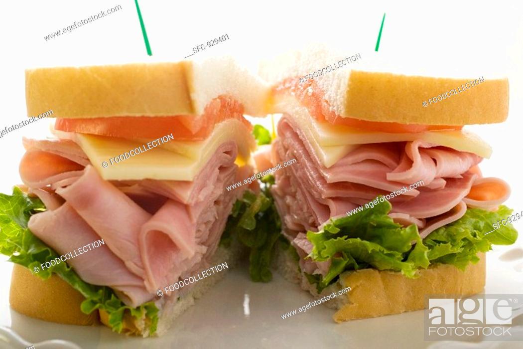 Stock Photo: Ham, cheese and tomato sandwich halved.