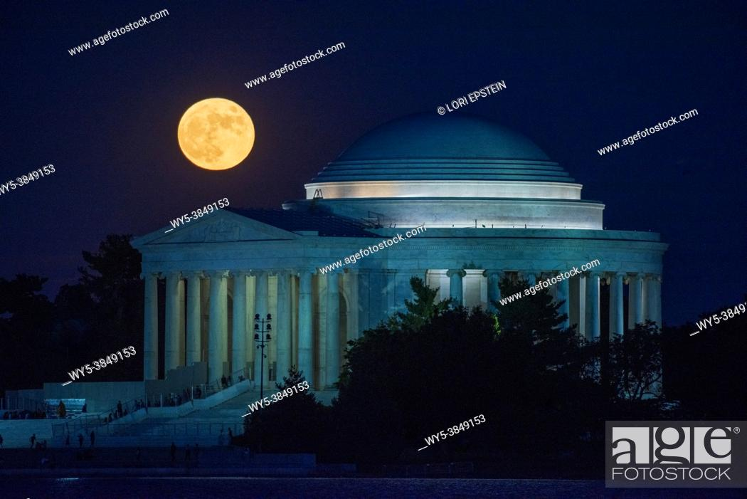 Stock Photo: The full moon rises above the Jefferson Memorial in Washington, D. C.