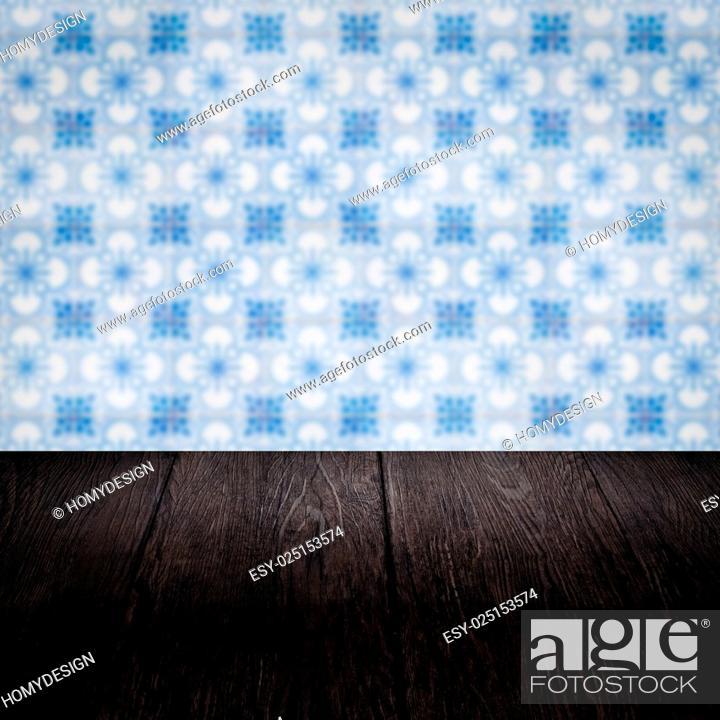 Stock Photo: Wood table top and blur vintage ceramic tile pattern wall.