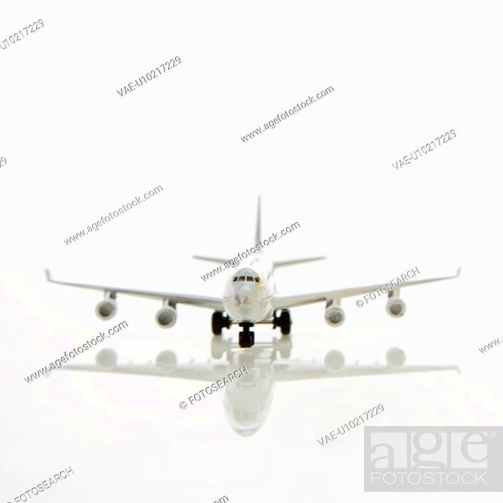 Stock Photo: Miniature toy airplane with jet engines.