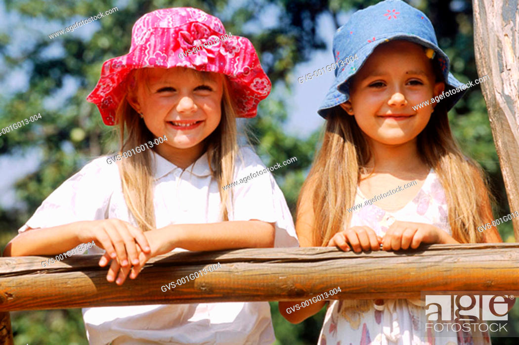 Stock Photo: Portrait of two girls standing outdoors.