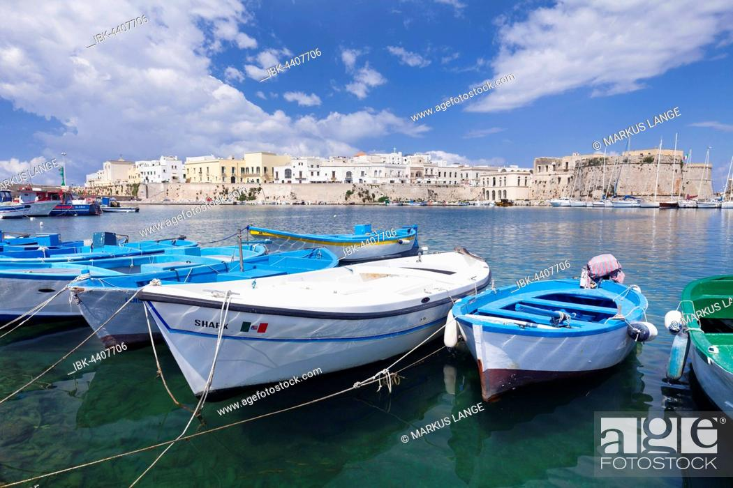 Stock Photo: Fishing boats in harbor with View of the historic centre with castle, Gallipoli, Province of Lecce, Salentine peninsula, Apulia, Italy.