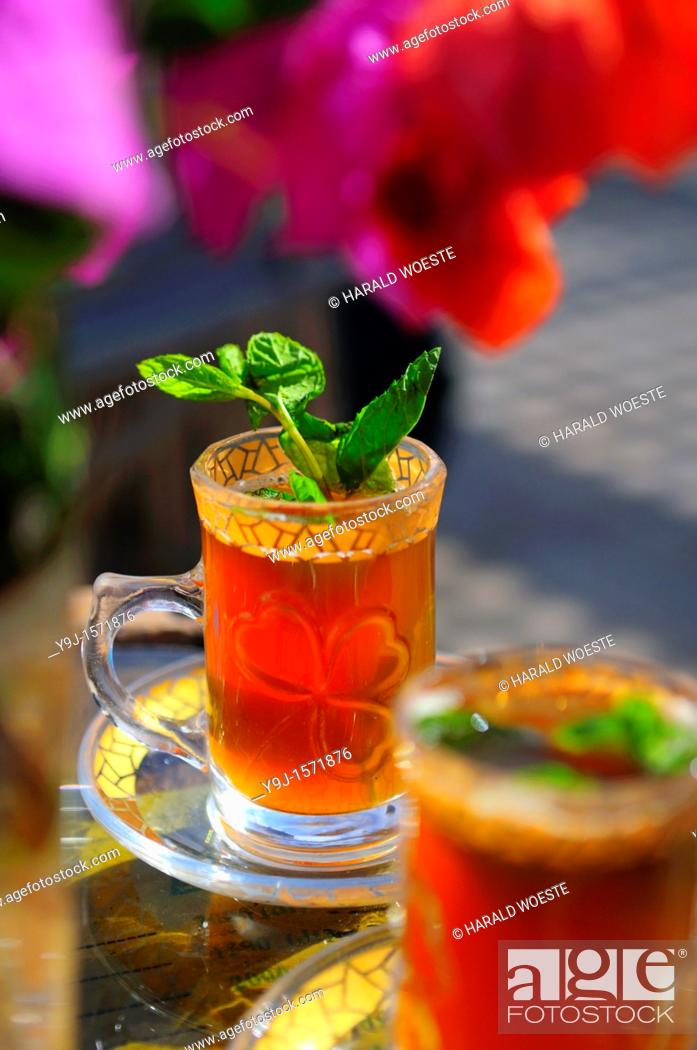 Stock Photo: Africa, Tunisia, Tozeur  Tea from fresh mint leaves.