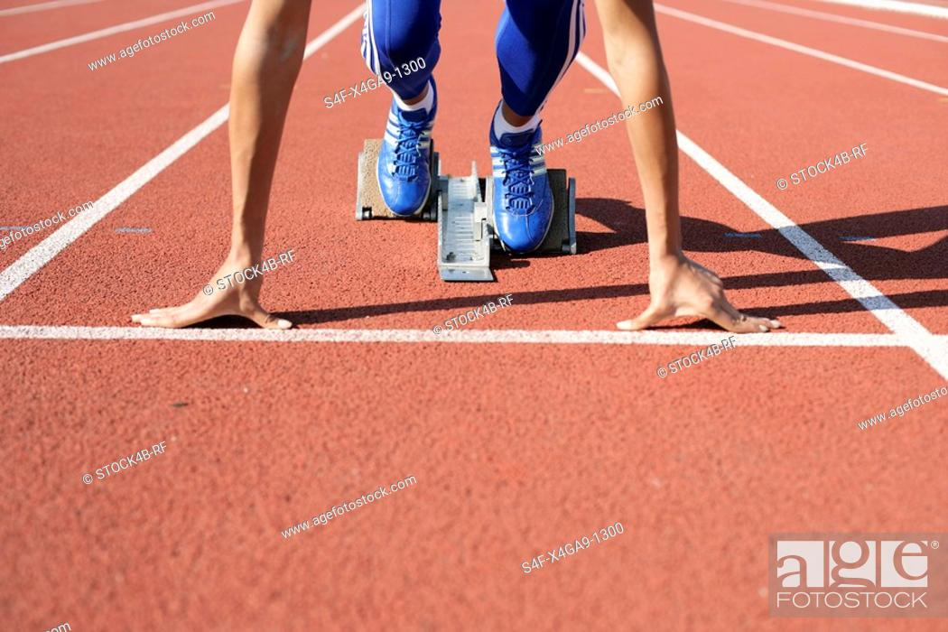 Stock Photo: Woman in starting block.