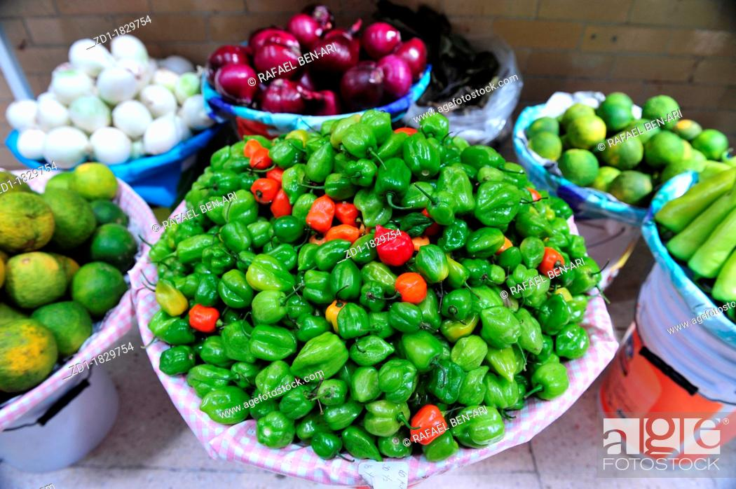 Stock Photo: An array of lemons, chillies and onions for sale at the Mexiican food market in Mexico City.