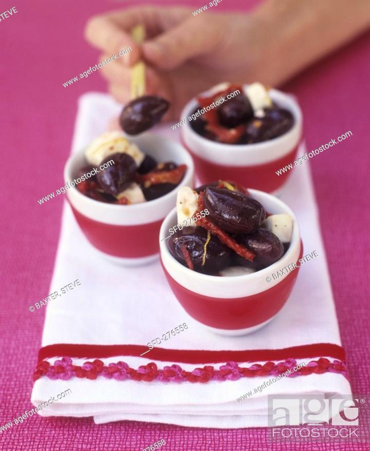 Stock Photo: Small bowls of pickled olives and sheep's cheese.