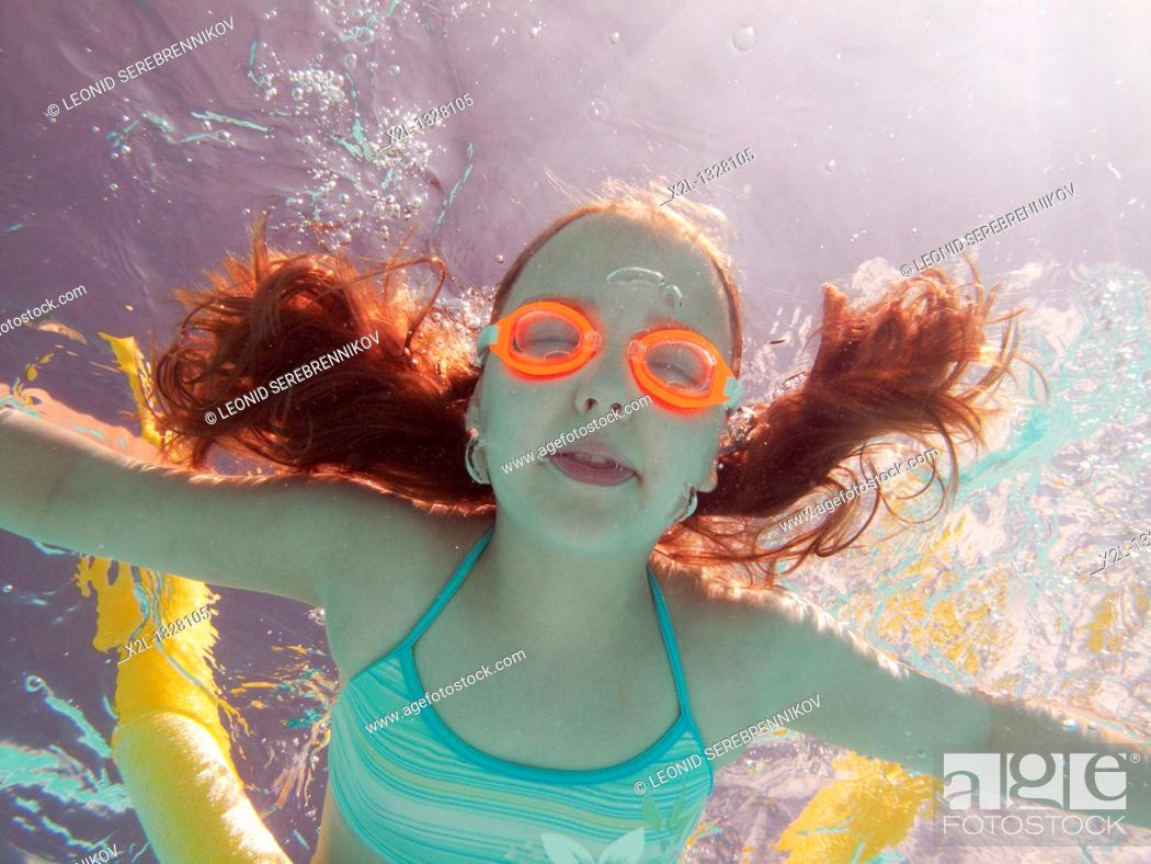 Stock Photo: Little girl diving in the pool.