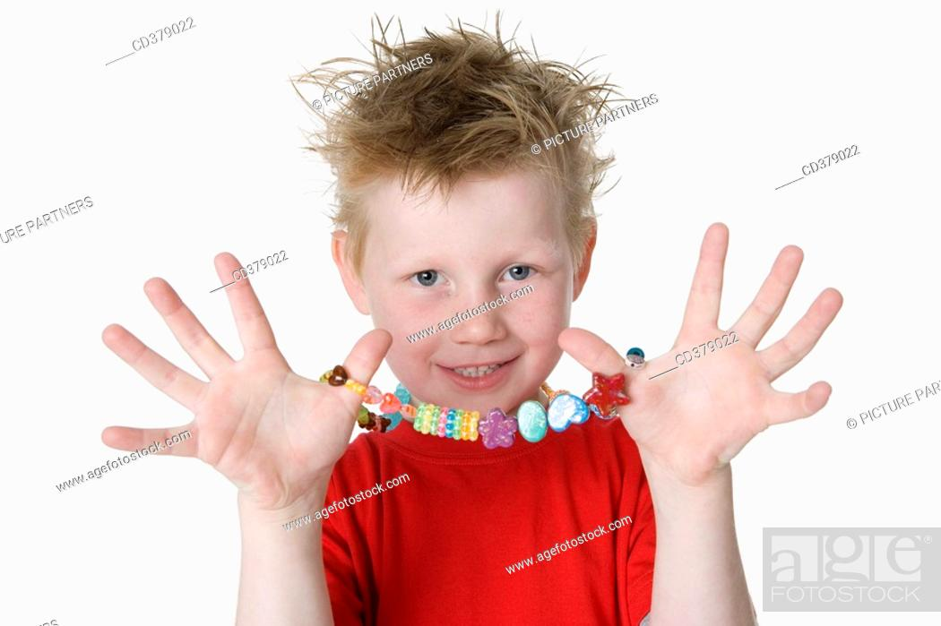 Stock Photo: Boy showing a necklace.