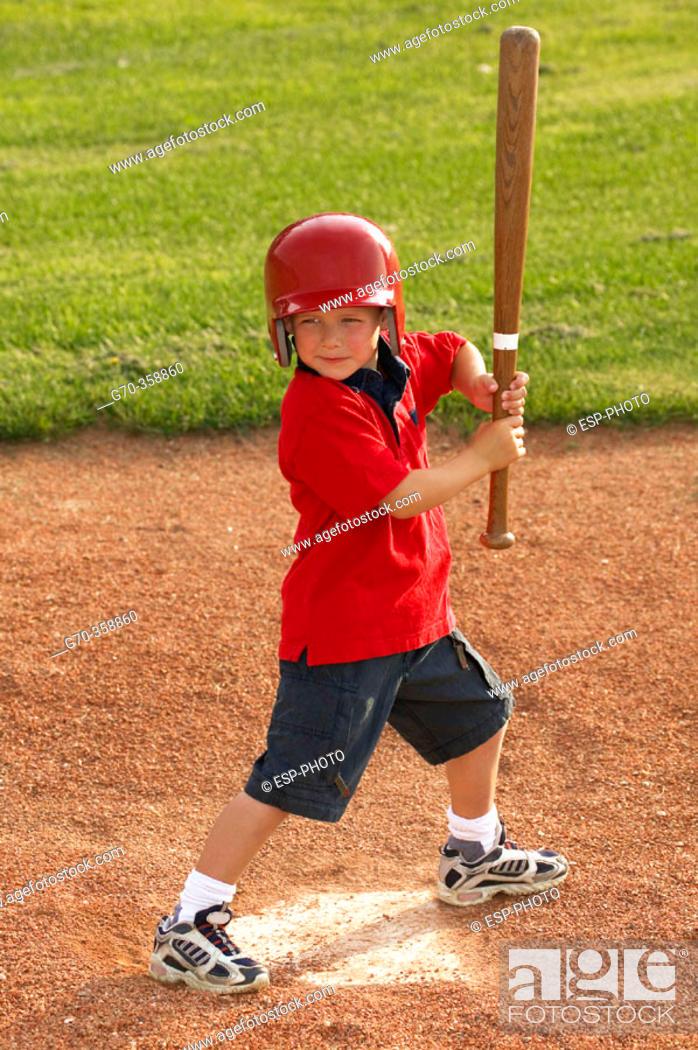 Stock Photo: Boy playing baseball ready to swing bat.