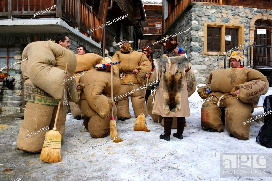 """Stock Photo: Switzerland, Valais, Val d'Herens, village of Evolene, Carnaval, preparation of the """"empailles"""" ( young men dressed with old bags stuffed with about 50 kgs of."""