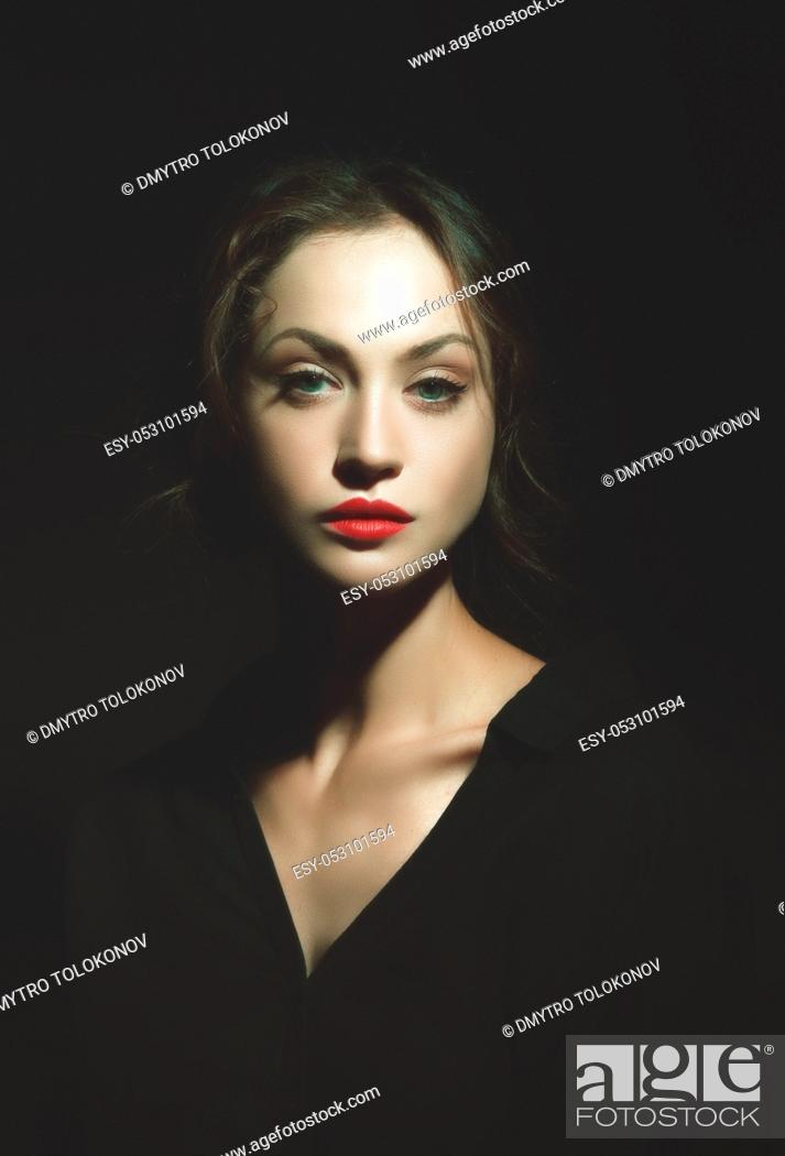 Stock Photo: Hiden in the shadows. Dark beauty female portrait.