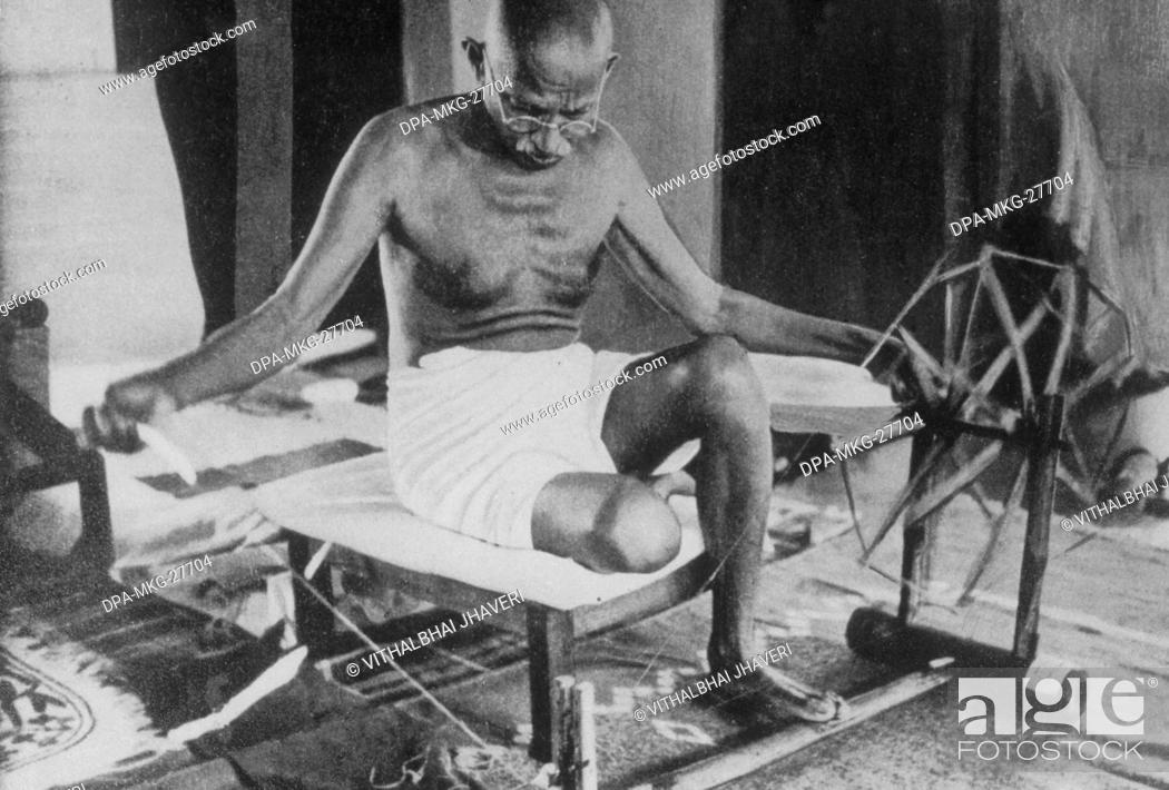 mahatma gandhi working on charkha India, Stock Photo
