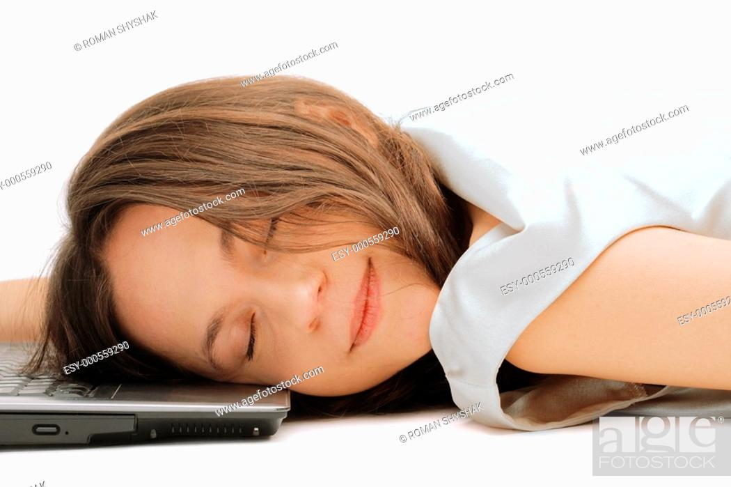 Stock Photo: Closeup of a young woman sleeping on the laptop.