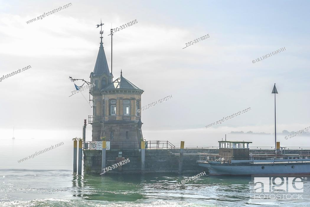 Stock Photo: Konstanz, Baden-Wurttemberg, Germany, Europe: Mist from Lake Constance spreads all over the harbour and encloses the lighthouse.