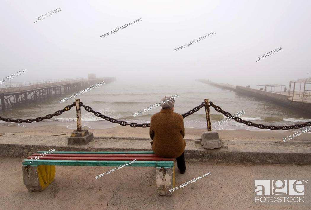 Stock Photo: A lone woman looks at the Black Sea in Odessa Ukraine.
