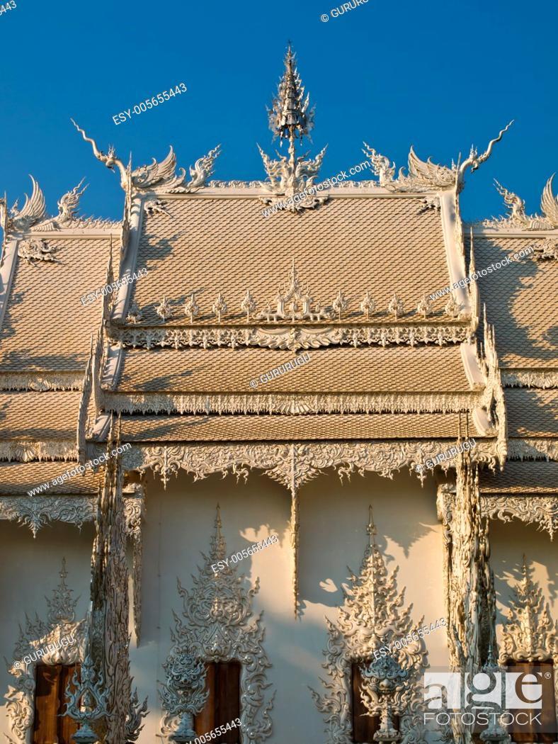 Stock Photo: Decoration of Buddhist Monastery, Wat Rong Khun at Chiang Rai, Thailand.