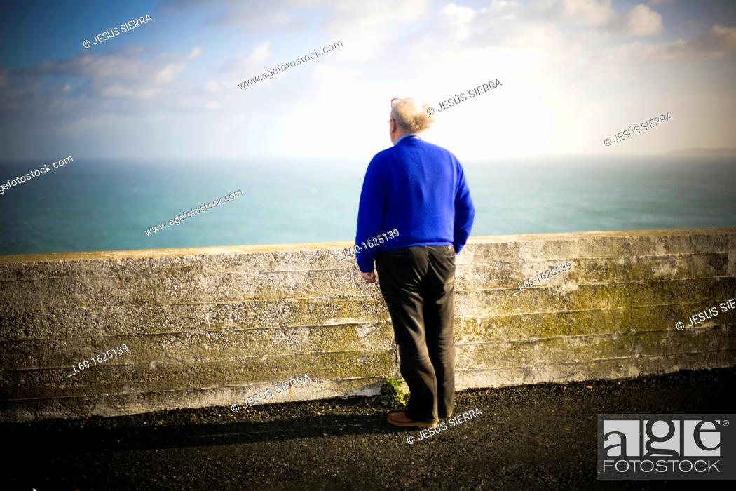 Stock Photo: Old man looking the sea, Ortegal cape, A Coruña, Galicia, Spain.