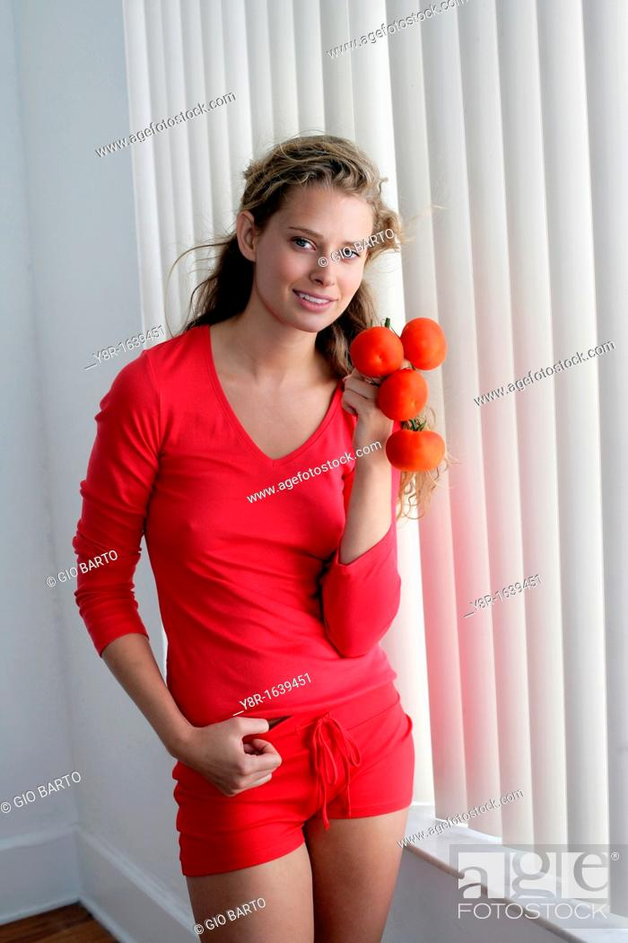 Stock Photo: woman with tomatoo.