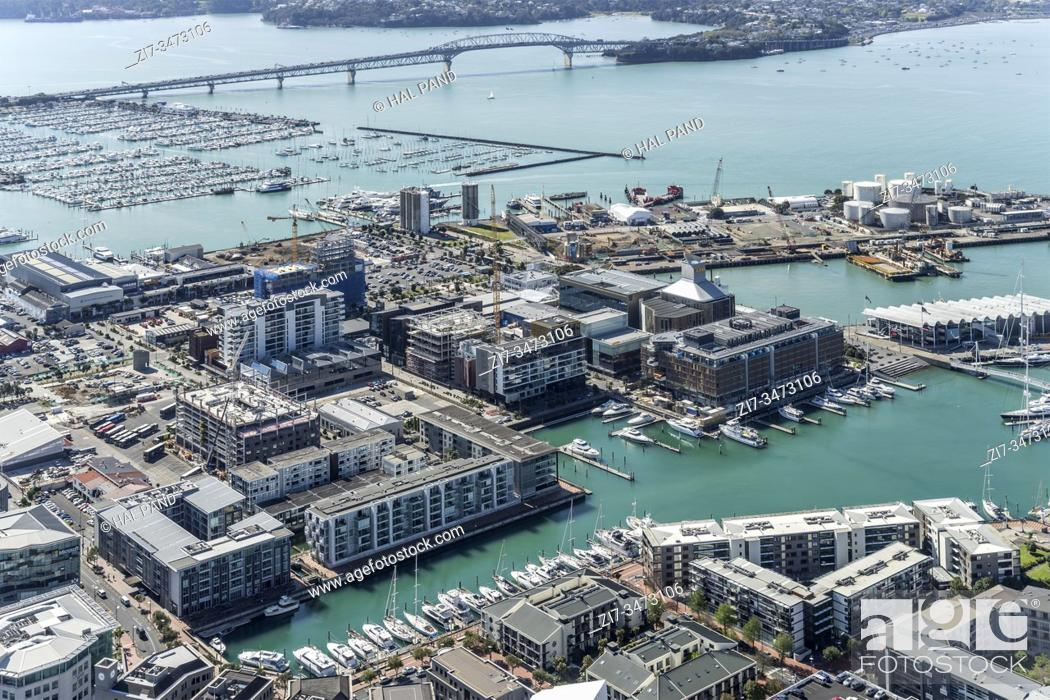 Stock Photo: AUCKLAND, NEW ZEALAND - November 05 2019: cityscape from above of leisure harbor and industrial quays at cool downtown of dynamic city.