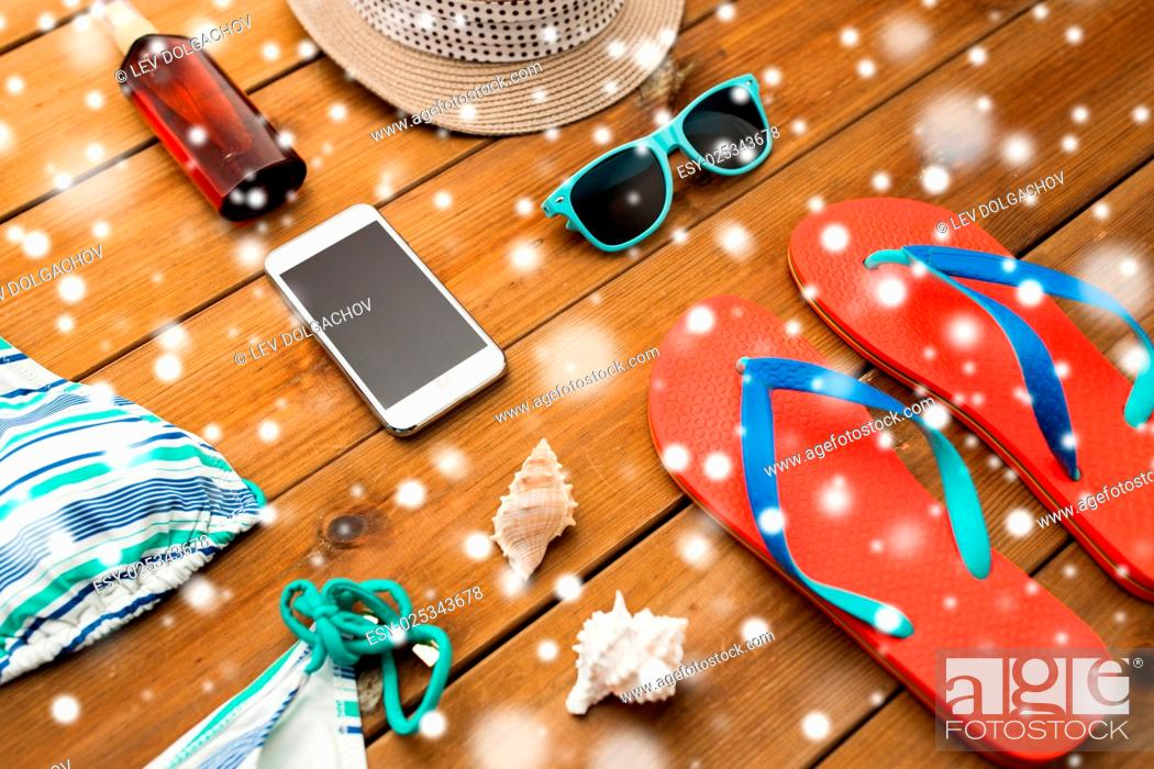 Stock Photo: vacation, travel, tourism, winter holidays and objects concept - smartphone and beach stuff.