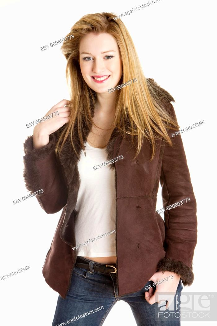 Stock Photo: portrait of standing young woman wearing jacket.