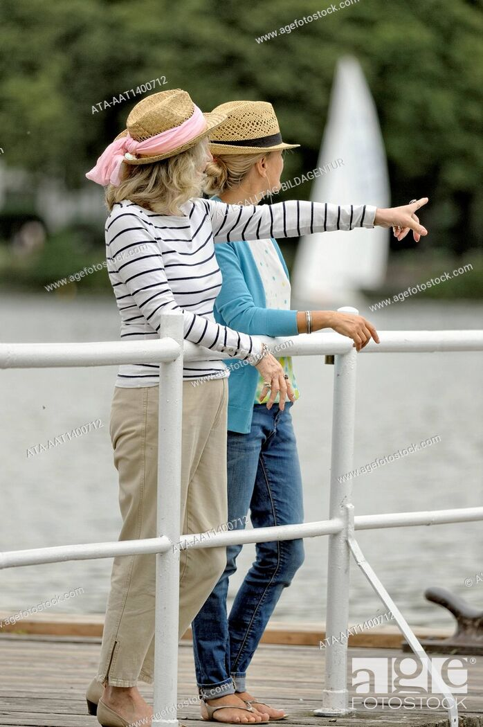 Stock Photo: Mother and daughter standing on a landing stage.
